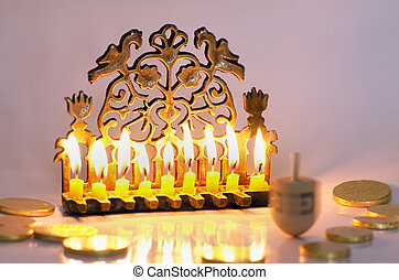 Jewish Holiday Hanukkah - Photo of a dreidel (spinning top),...