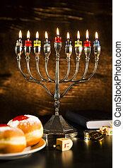 Jewish Holiday Hanukkah With Menorah, Torah, Donuts And Wooden Dreidels