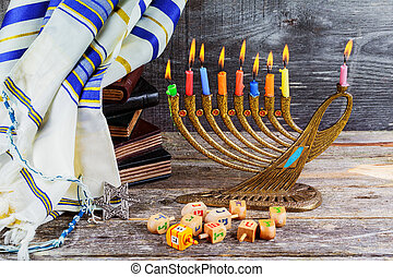 jewish holiday Hanukkah with menorah traditional Candelabra and wooden dreidels spinning top