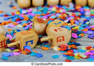 jewish holiday Hanukkah with wooden dreidel the glitter background