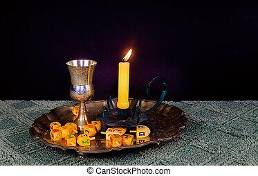 jewish holiday Hanukkahand wooden dreidels