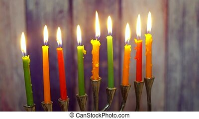 Brightly Glowing Hanukkah Menorah - Shallow Depth of Field...