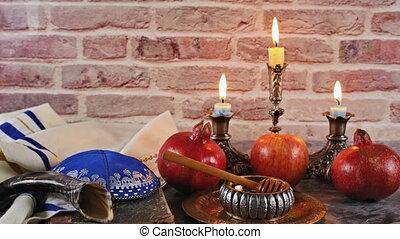 Jewish Holiday Rosh hashanah honey and apples with pomegranate traditional symbols