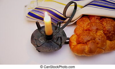 Jewish holiday Sabbath image. matzoh jewish passover and candle on wooden table