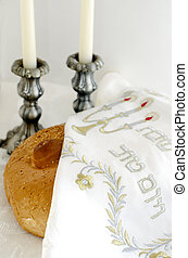 Jewish Holiday Shabbat - A concept photo of covered challah...