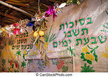 Jewish Holiday Sukkoth - Decorations inside a sukkah during...
