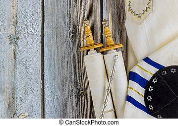 Jewish holidays, during prayer items kippa with prayer shawl tallit on shofar, torah scroll