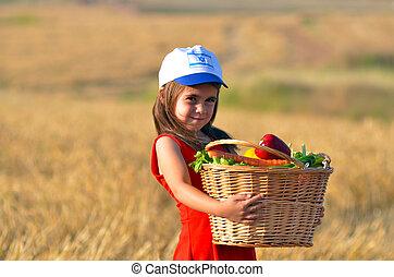 Jewish Israeli girl with fruit basket on Shavuot Jewish...