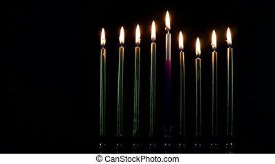 Jewish lights holiday of chanukah a burning menorah symbol of Judaism traditional jewish holiday