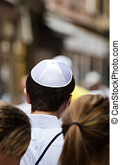 Jewish man in a crowd on the street of Jerusalem