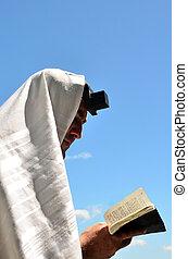 Jewish man pray - Jewish man wearing Tallit and Tefillin...