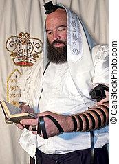 Jewish Man Praying - An Israeli Jewish orthodox man prays in...