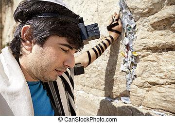 Jewish Man Praying at the Western Wall - A Jewish adult...