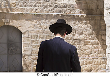Jewish man walking in the ancient streets of the old city of Jerusalem