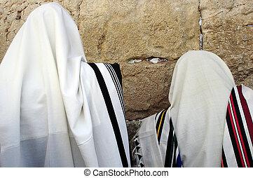 Jewish Men Praying - Jewish Men are praying wrapped in talit...