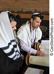 Jewish Men Reading and Praying from a Torah Scroll