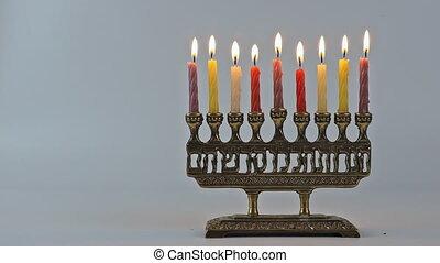 Jewish Menorah lighting Hanukkah candles burning
