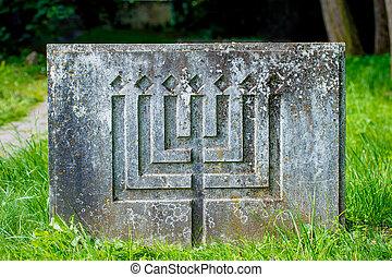 Jewish monument, Jewish candlestick on the rock.