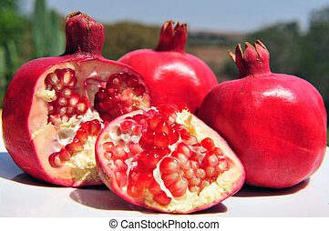 Jewish New Year Symbols - Pomegranate fruit with pips in an...