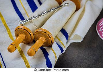 Jewish Orthodox holidays, during prayer items prayer shawl tallit with torah scroll