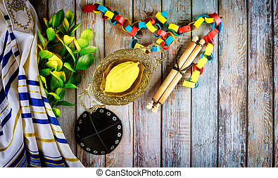 Jewish ritual festival of Sukkot in the jewish religious symbol Etrog, lulav, hadas, arava tallit praying book kippah and shofar