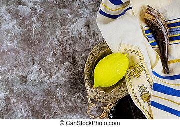 Jewish ritual Sukkot festival in the jewish religious symbol Etrog, lulav, hadas, arava tallit praying book kippah and shofar