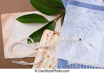 Jewish symbols - Matzah and a blue and white tallit laying...