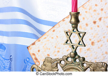 Jewish symbols - Menorah and matzah in front of a blue and...