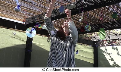 Jewish woman decorating Sukkah