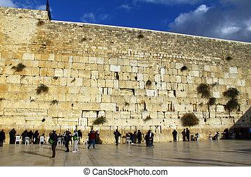 Jewish worshipers pray at the Wailing Wall an important jewish religious site at winter