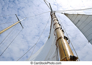 Jib and Wooden Mast of Schooner Sailboat on a Sunny Summer Day