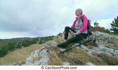 JIB CRANE: Day hiking in Crimean mountains woman hiker...