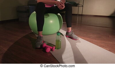 JIB CRANE: Fit girl working out in fitness club drinking...