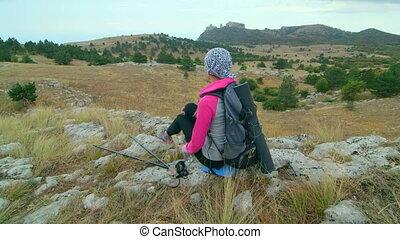 JIB CRANE: Woman hiker hiking mountain highlands relaxing on...