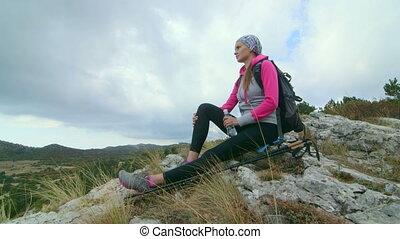 JIB CRANE: Young woman hiker on mountain top enjoying view of plateau Ai-Petri