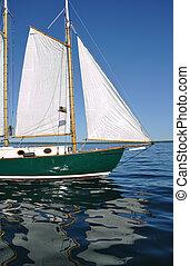 Jib, Foresail, and Wooden Mast of Schooner Sailboat