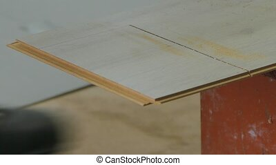 Jig saws the laminate on the markings - Hands using electric...