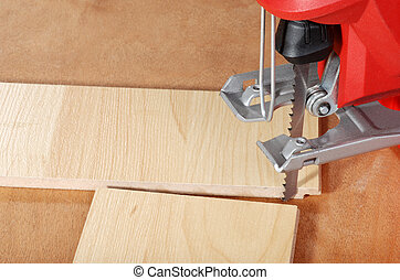 jigsaw and cut wood flooring