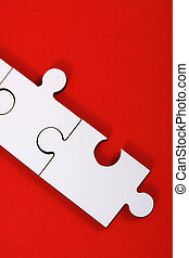 Jigsaw pieces on red