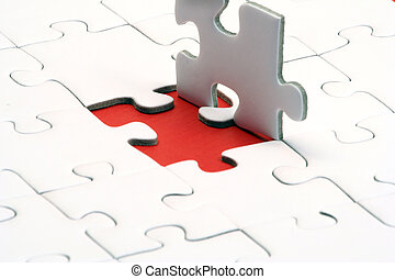Jigsaw Puzzle - A typical jigsaw puzzle with a red gap.