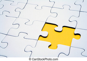 Jigsaw Puzzle - A typical jigsaw puzzle with a single yellow...