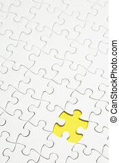 Jigsaw Puzzle. - Plain white jigsaw puzzle, on Yellow...
