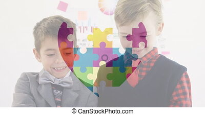 Digital composite video of Jigsaw puzzle forming a heart against two smiling boys holding a placard. Autism Awareness concept.