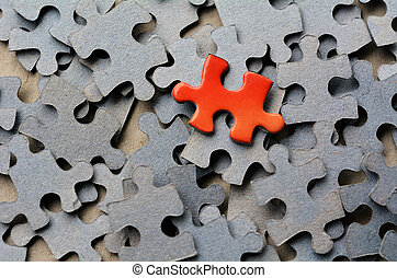 Jigsaw puzzle - Orange puzzle pice standing out from larger ...