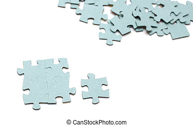 Jigsaw puzzle - the puzzle pieces on white background