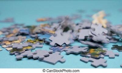 Jigsaw puzzle pieces falling down. Falling down randomly ...