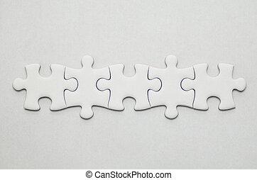 Jigsaw puzzle. - Plain white jigsaw puzzle, on White...