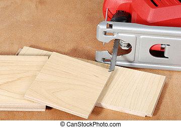 jigsaw with cut wood flooring