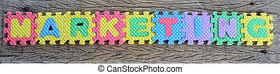 jigsaw written marketing word on wood background