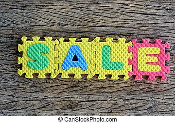 jigsaw written sale word on wood background